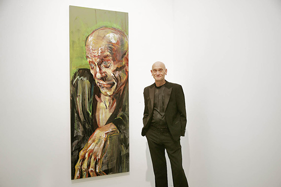 model in front of his portrait